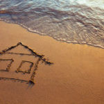 stock-photo-house-painted-on-the-beach-home-on-the-sea-148772648